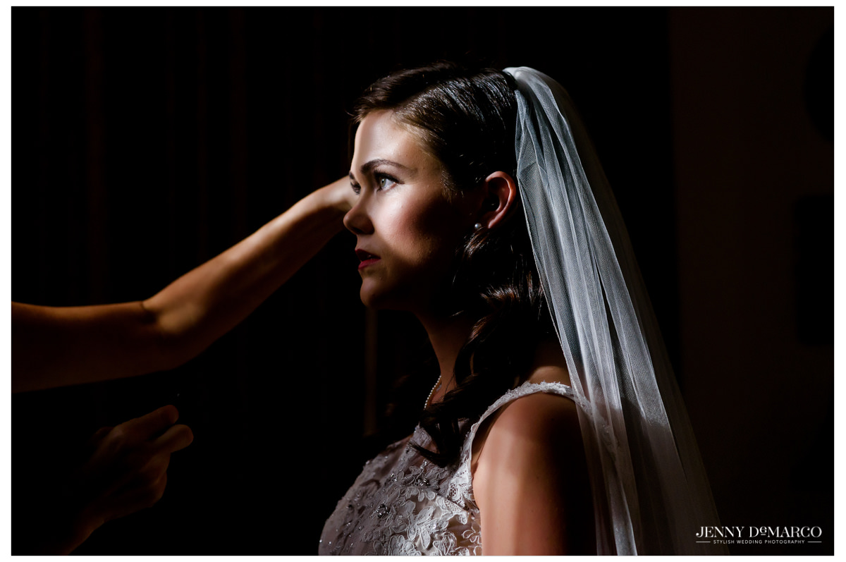 The final touches on the bride on her wedding day.