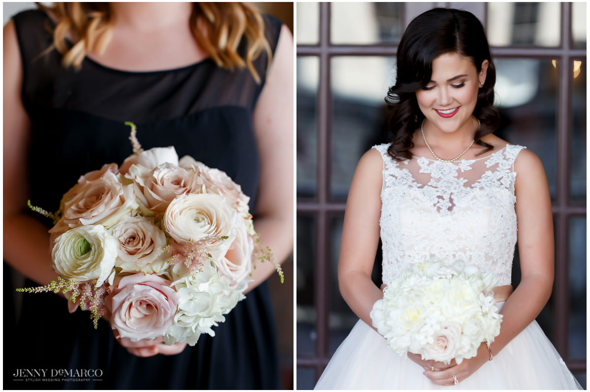 The bride and her maid of honor holding rose bouquets by David Kurio design