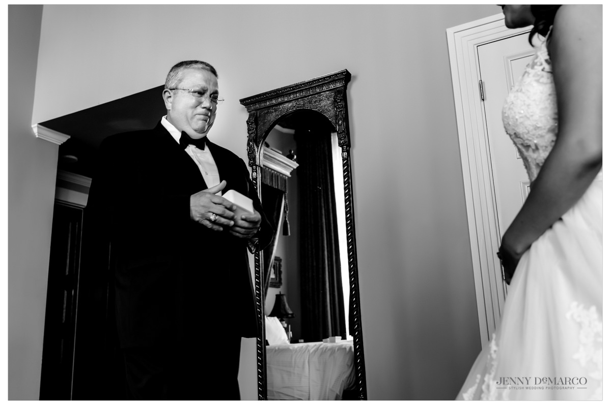 Father seeing his daughter in her wedding dress for the first time.