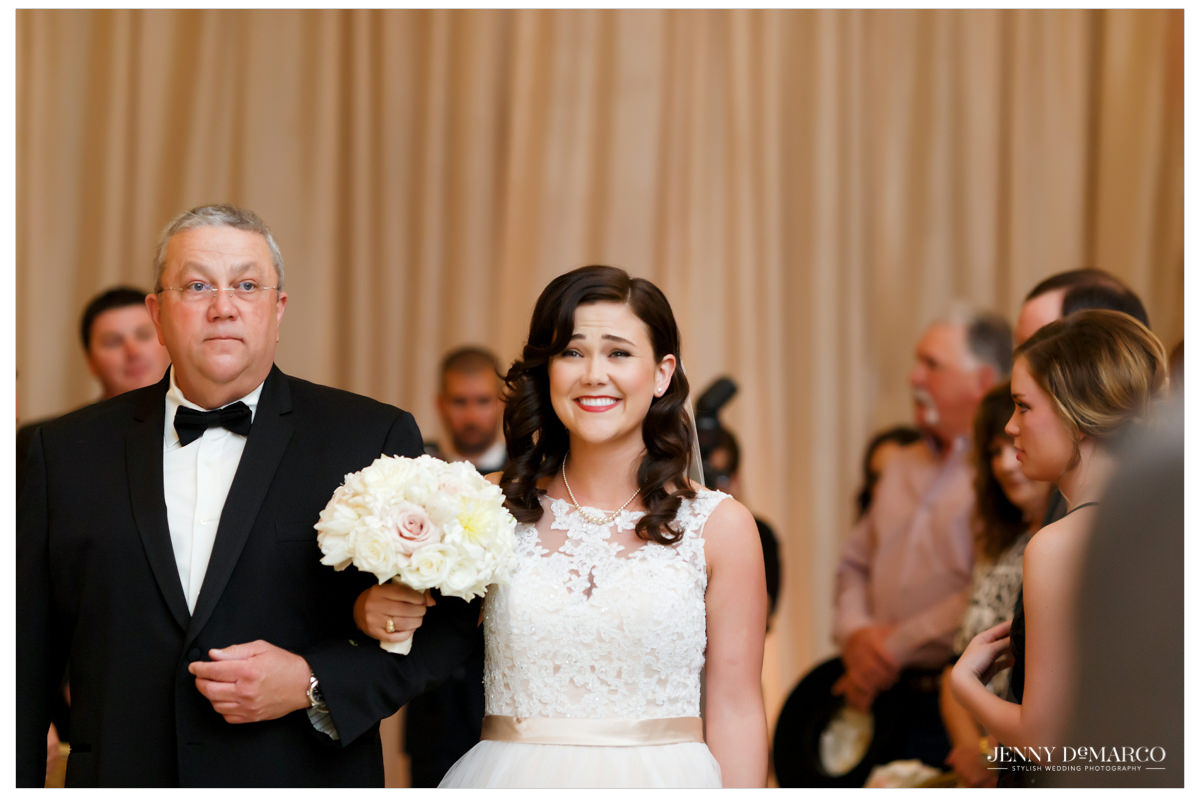 Father walking his daughter down the aisle at her wedding.