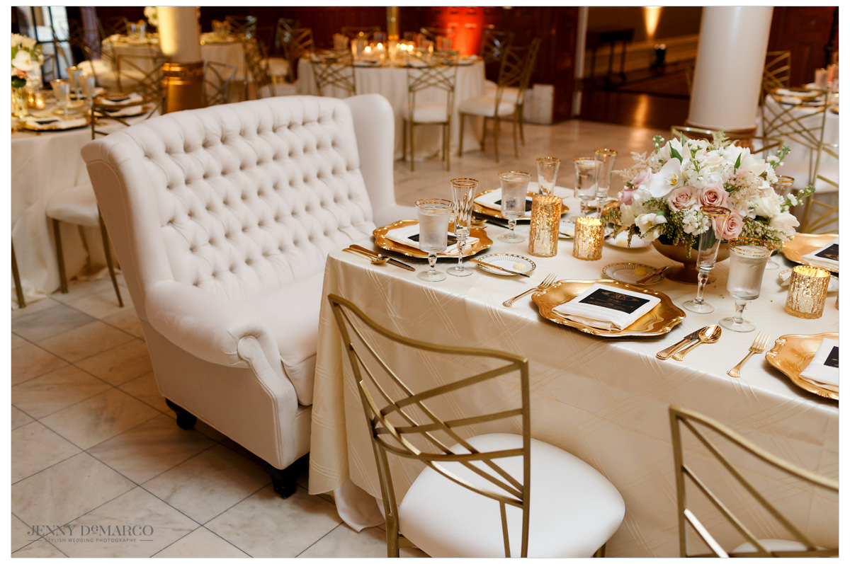 Glamorous and plush loveseat for the bride and groom at the reception.