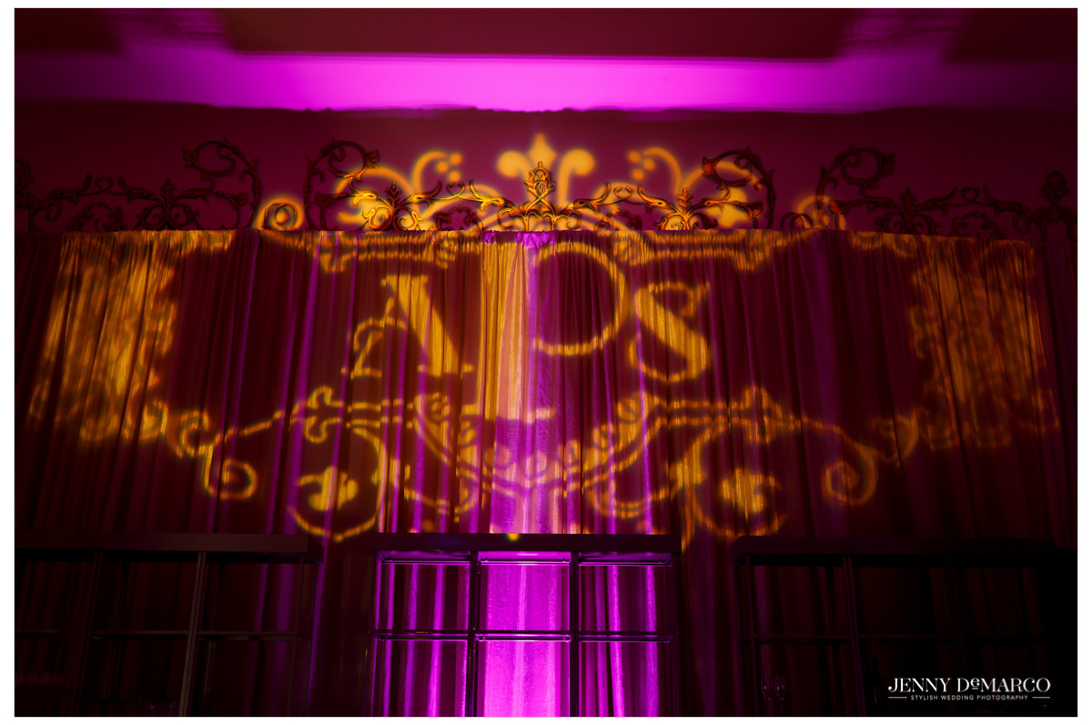 The couples' initials are portrayed against the wall of the reception hall.