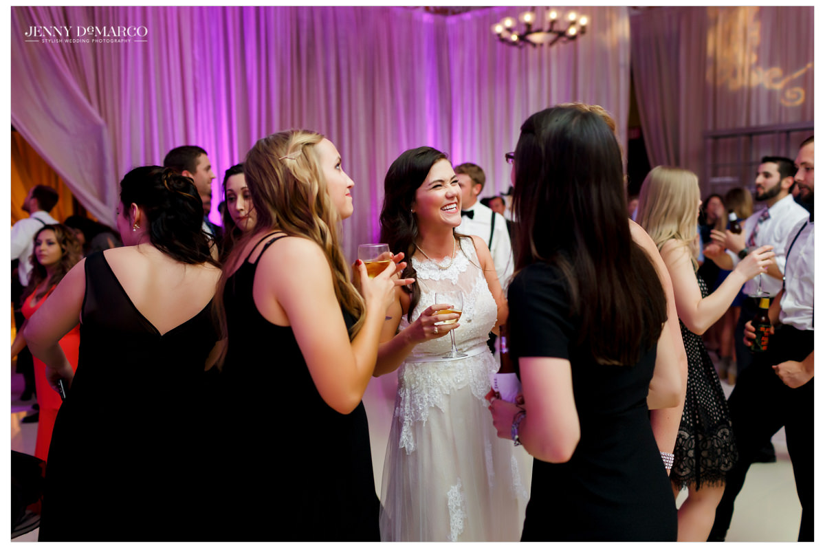 Bride having fun talking to her guests at the reception.