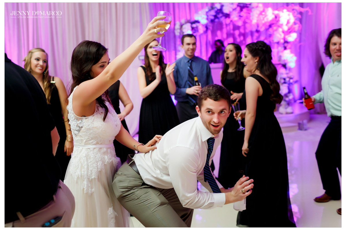Bride dances with one of her guests.
