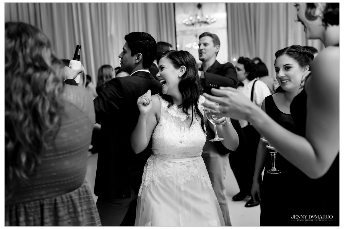 Bride having fun on the dance floor with her guests.