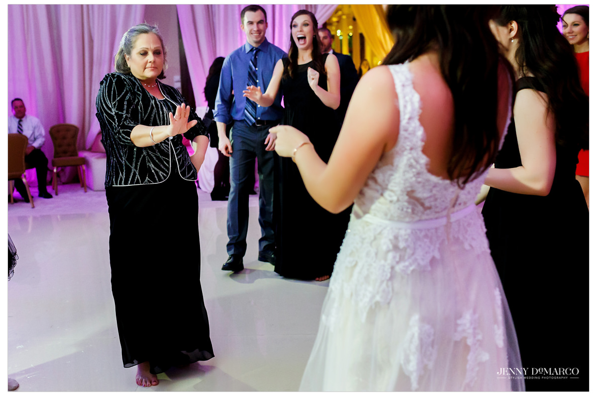 Mother of the bride dancing with her daughter