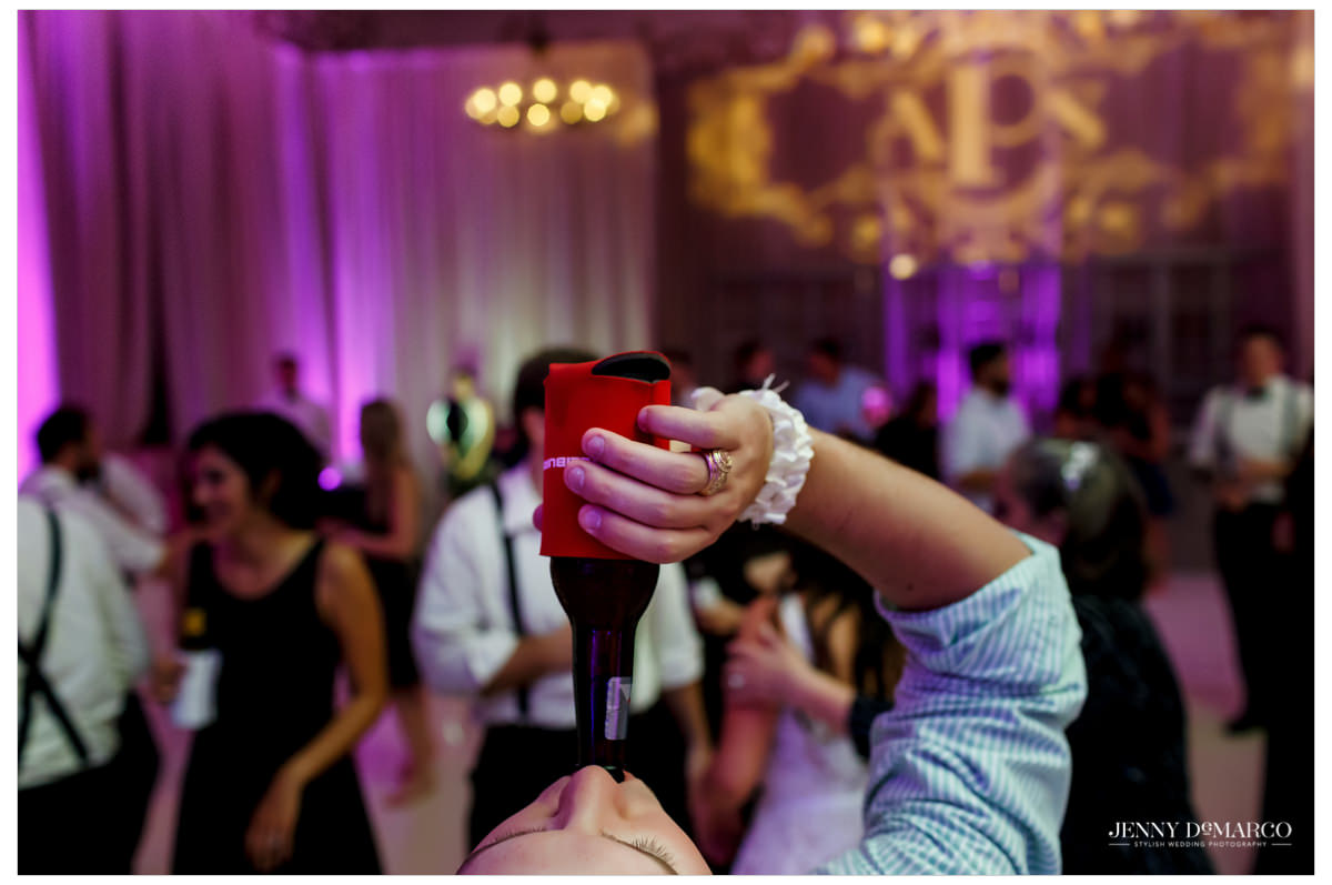Fun reception shot with groom's class ring.