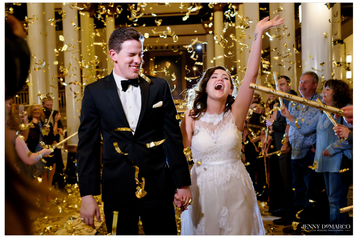 happy couple exits their wedding at the Driskill with confetti