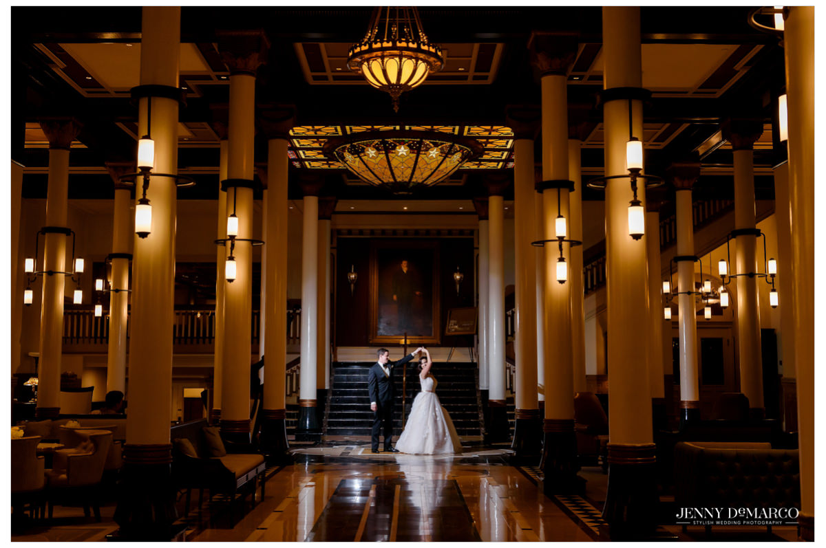 The bride and groom share an intimate moment in the lobby of the Driskill hotel.