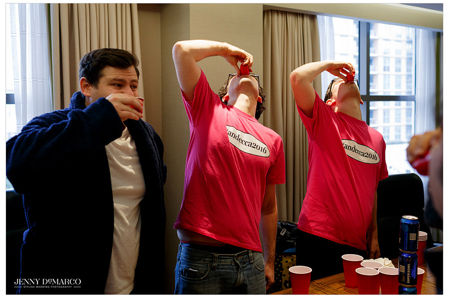 The groom and his groomsmen take shots before getting dressed and ready for the big day.