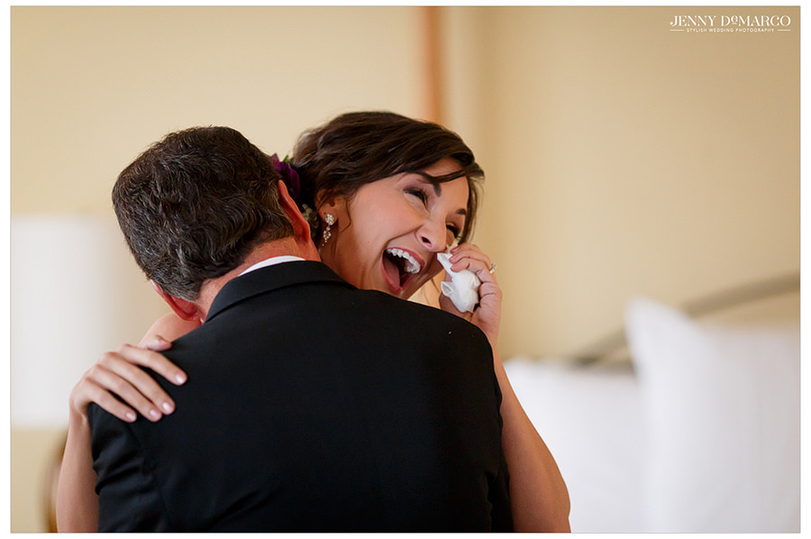 The father of the bride and his daughter hug and share a loving moment before the ceremony.