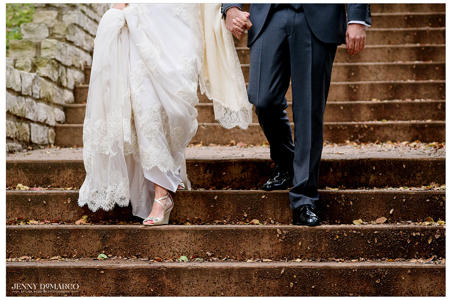 A close up of the bride and groom's steps down the stairs at the Four Season's hotel.