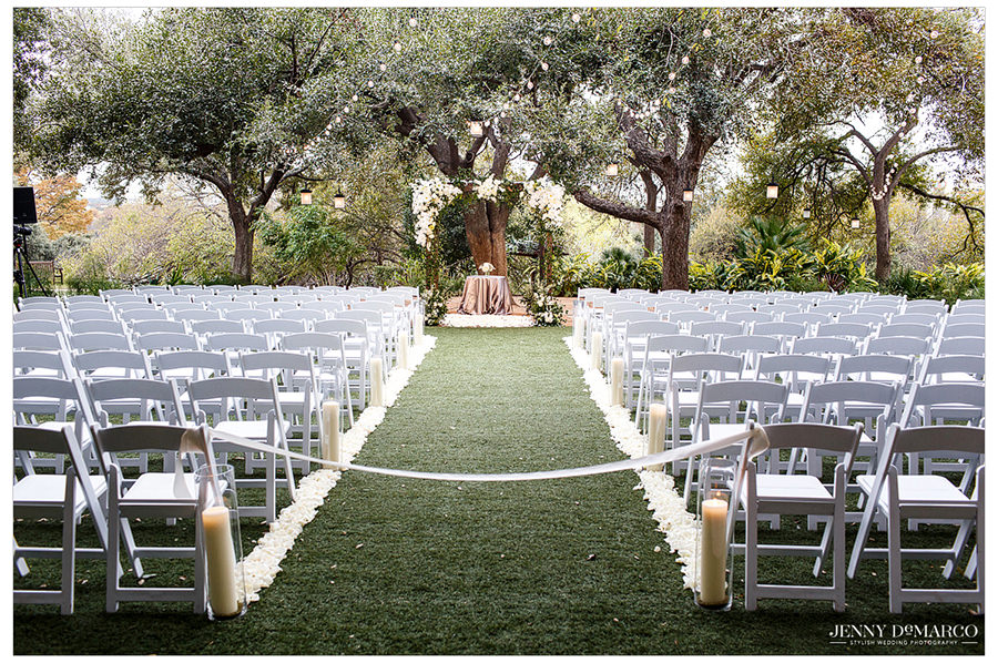A portrait of the Four Season's lawn prepared for the ceremony with white lights and greenery.