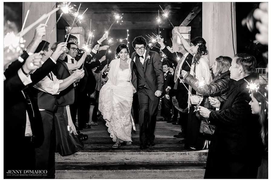 Guest's gather with sparklers outside of the venue to watch as the bride and groom make their exit.