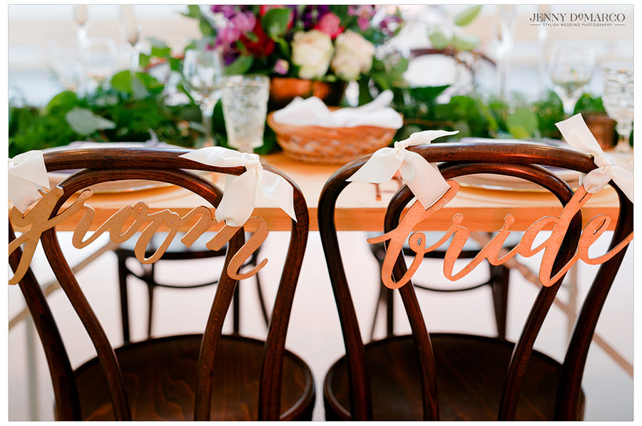 The chairs at the main dining room labeled for the bride and the groom.