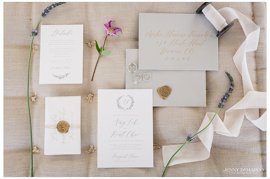 The invitations and rings for the wedding.