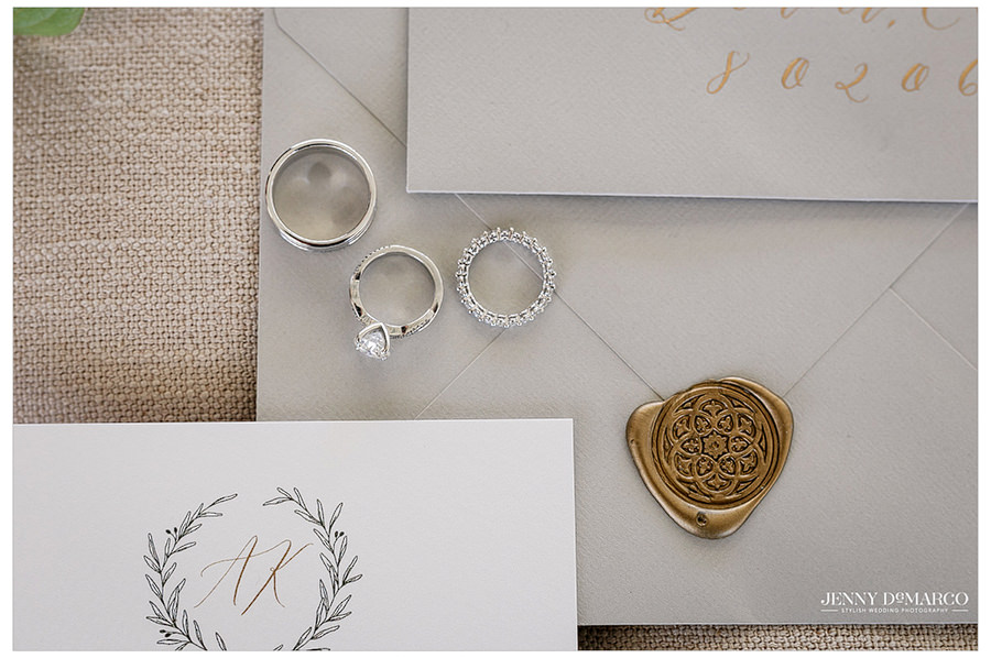 The rings for the wedding and a beautiful seal enclosing the wedding invitation.