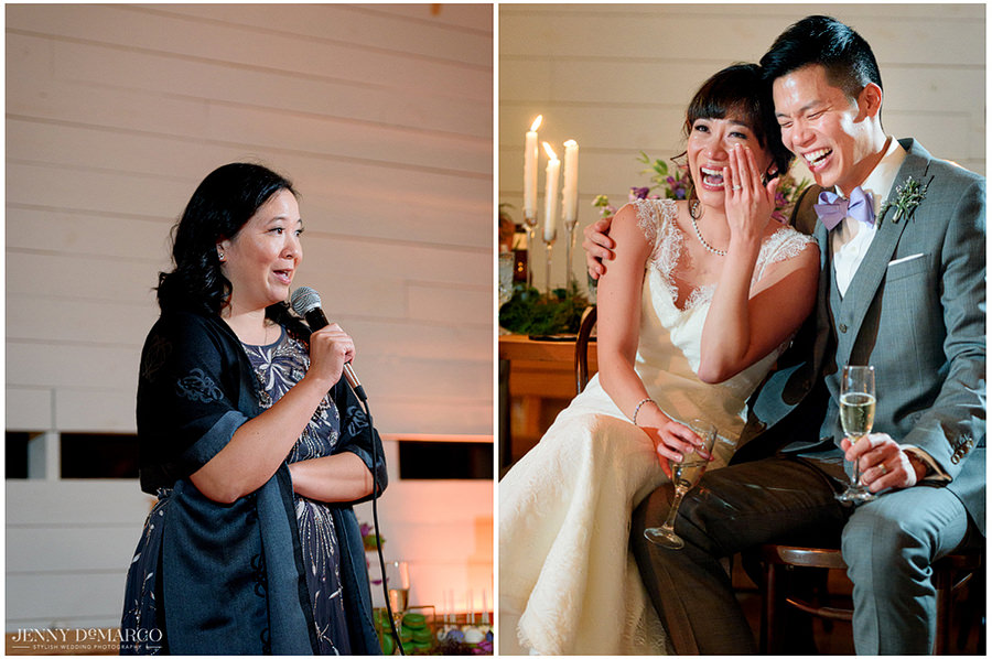 The guests give a toast to the bride and groom and their laugh and listen together.