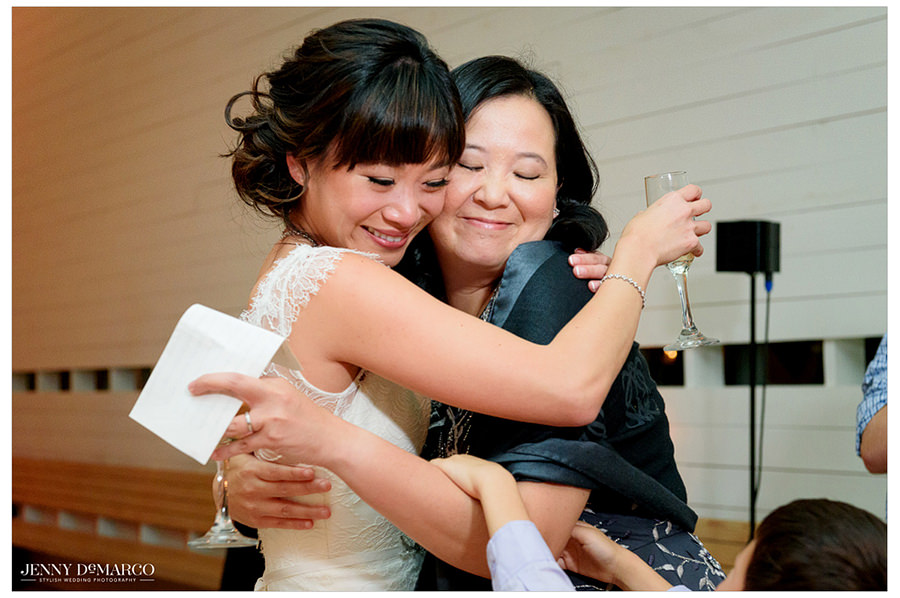 The bride hugs one of her guests.
