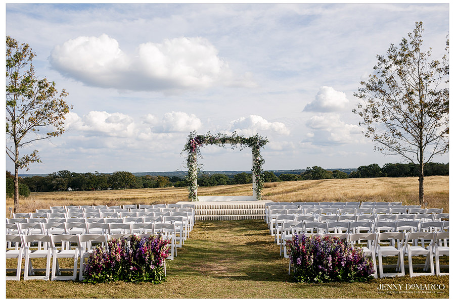 A landscape shot of the site of the wedding ceremony decorated beautifully with flowers.