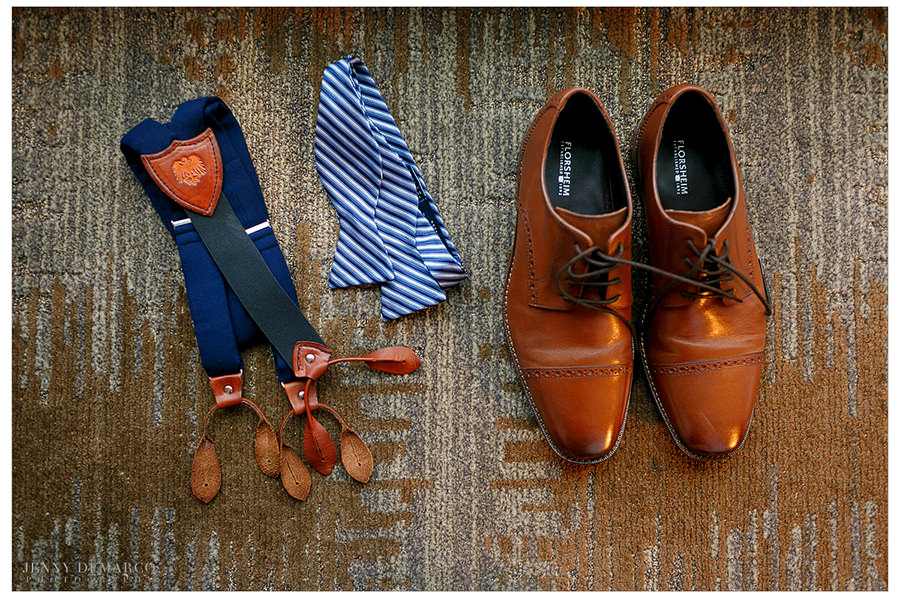 All the groom's accruements for getting ready on his wedding day include his suspenders and snazzy shoes.