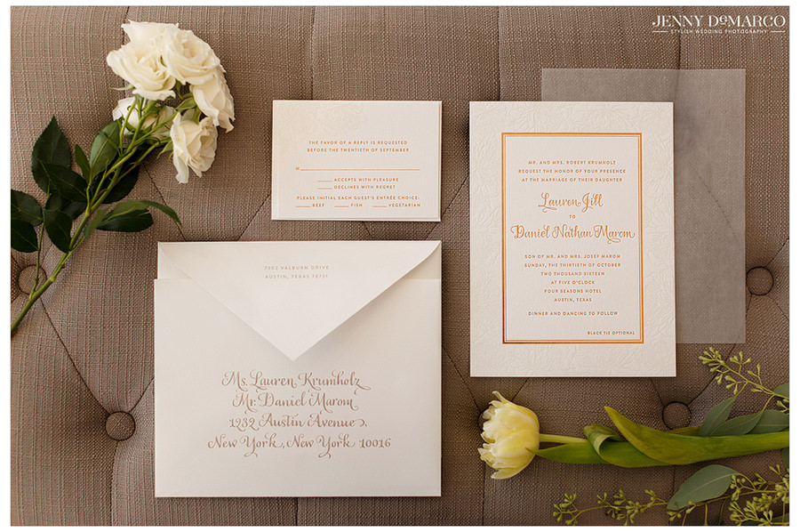 Custom wedding invitations with white flowers.