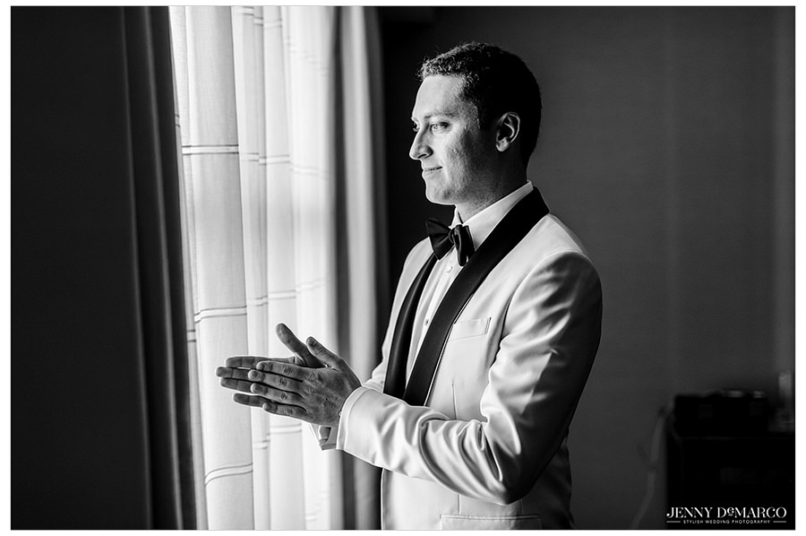 Portrait of the groom while he waits for the bride to finish up and anxiously awaits his first look.