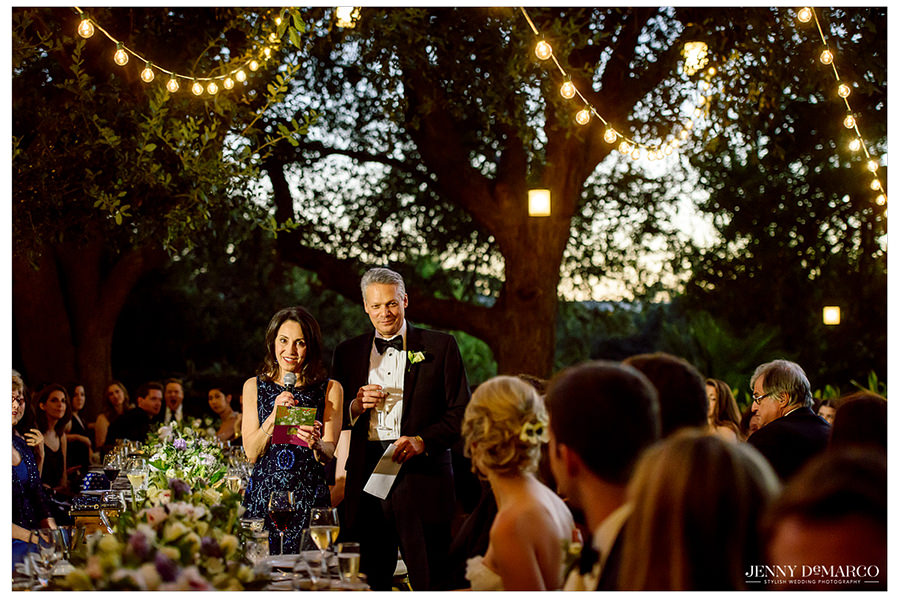 The brides parents giving a toast as the sunsets on the Four Seasons lawn outside.