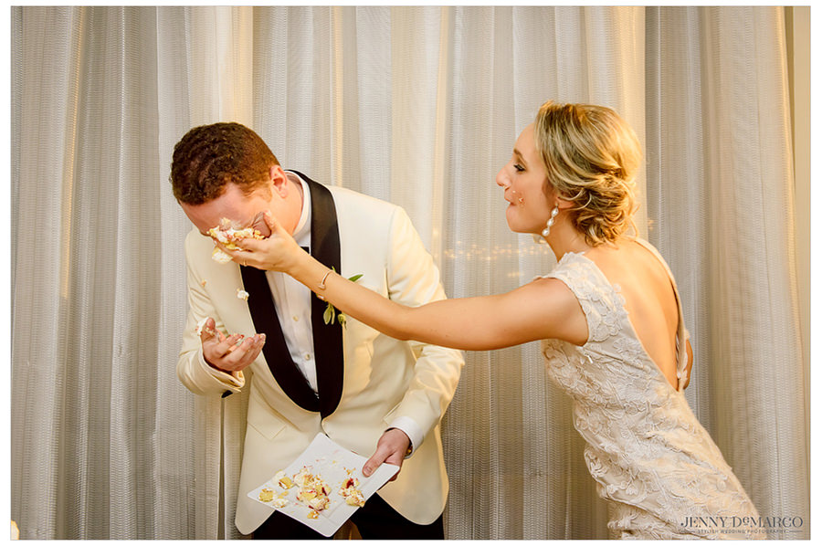 The bride smashing cake in the grooms face.