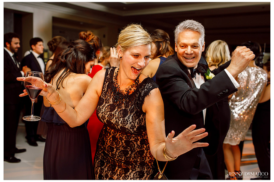 The brides dad dancing with other wedding guest celebration his daughters big day.