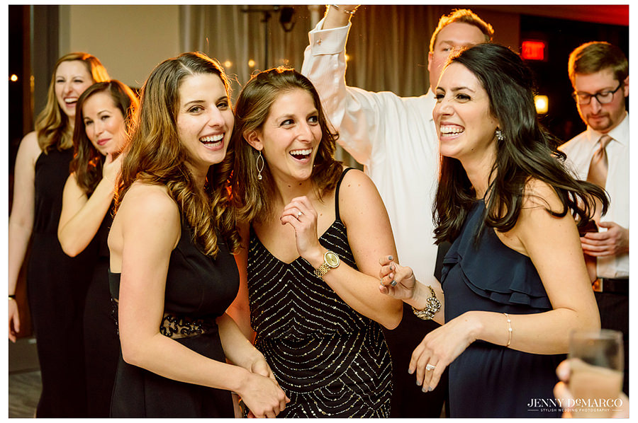 Some of the guest dancing and having fun during the wedding reception.