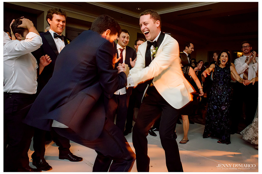 The groom dancing with one of his groomsmen.