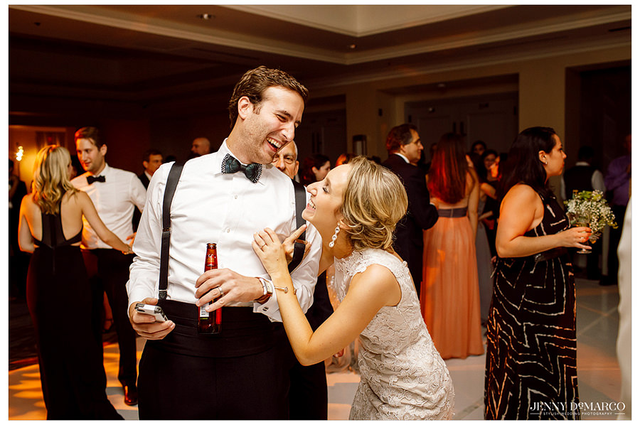 The bride joking around with a guest at the Four Seasons Hotel at the reception.