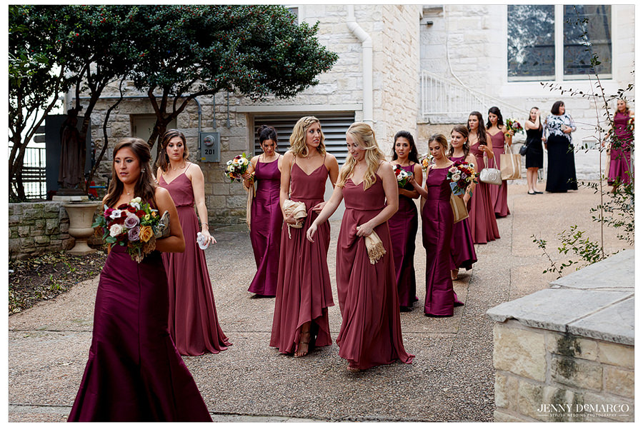 Bridesmaids walking next to St. Mary's before the wedding procession.