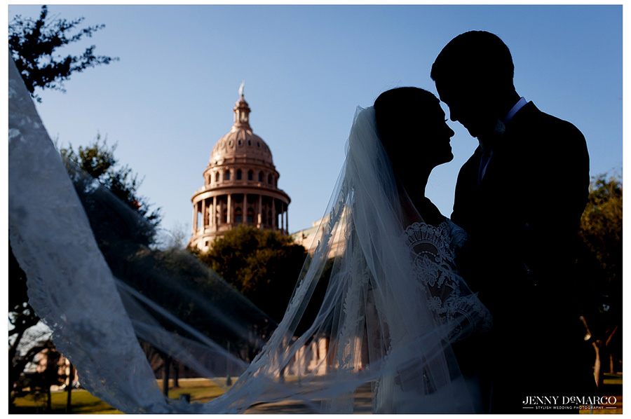 Bride and groom in front of the Texas State Capital.