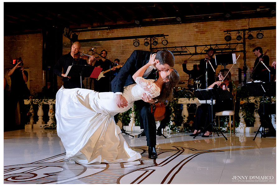 Bride and groom first dance dip at Brazos Hall wedding reception.