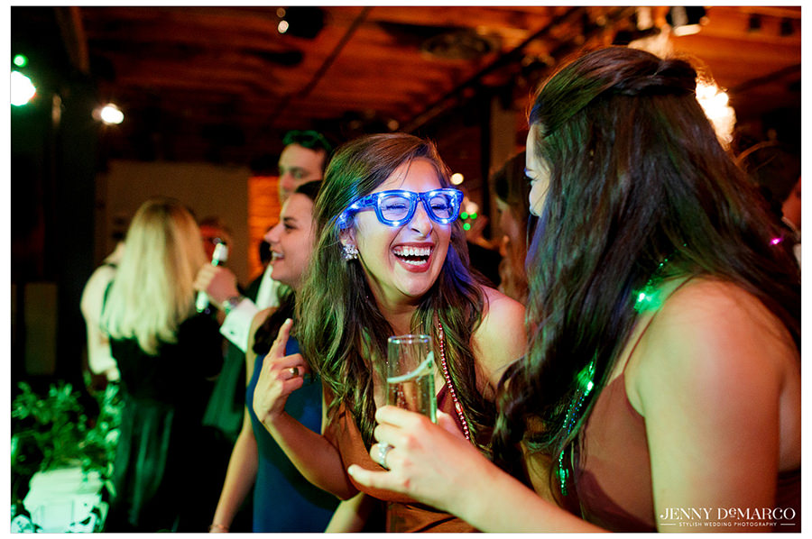 Guest laughing at light up glasses.