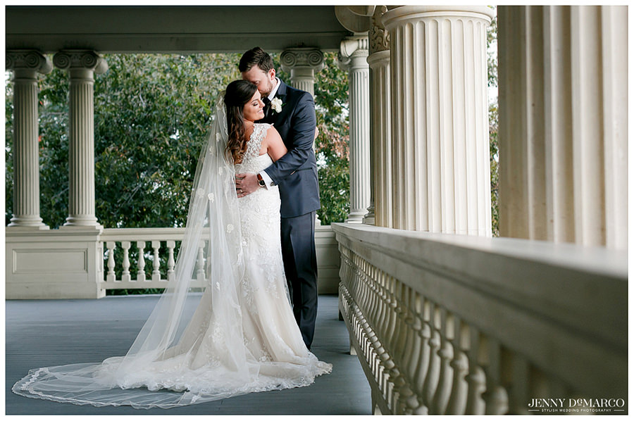 Bride and Groom sharing a moment on the porch of wedding venue.