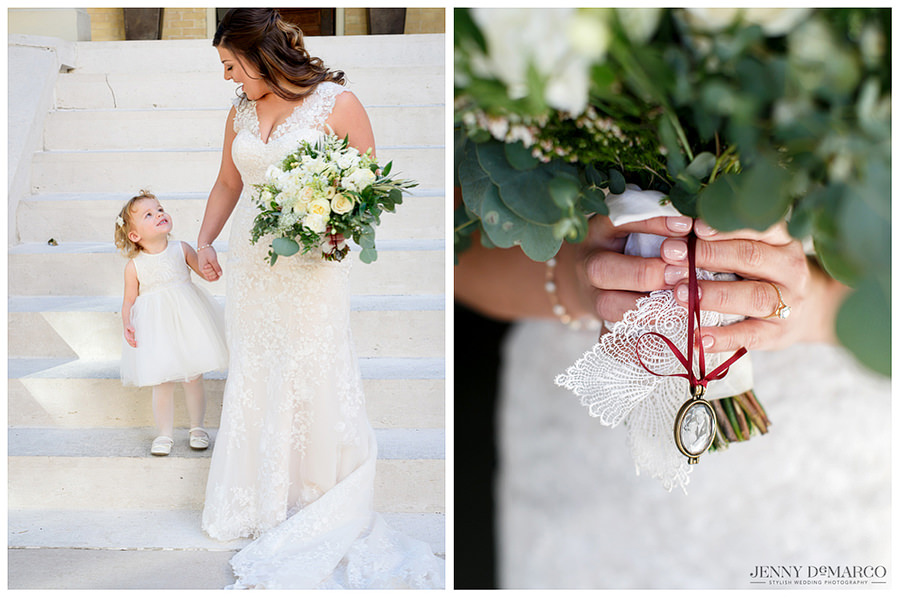 Bride and daughter holding hands and bridal bouquet by Verbena Floral.