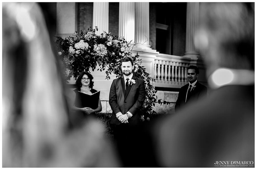 Groom seeing his future wife walking down the aisle for the first time at Hotel Ella in Austin, Texas.