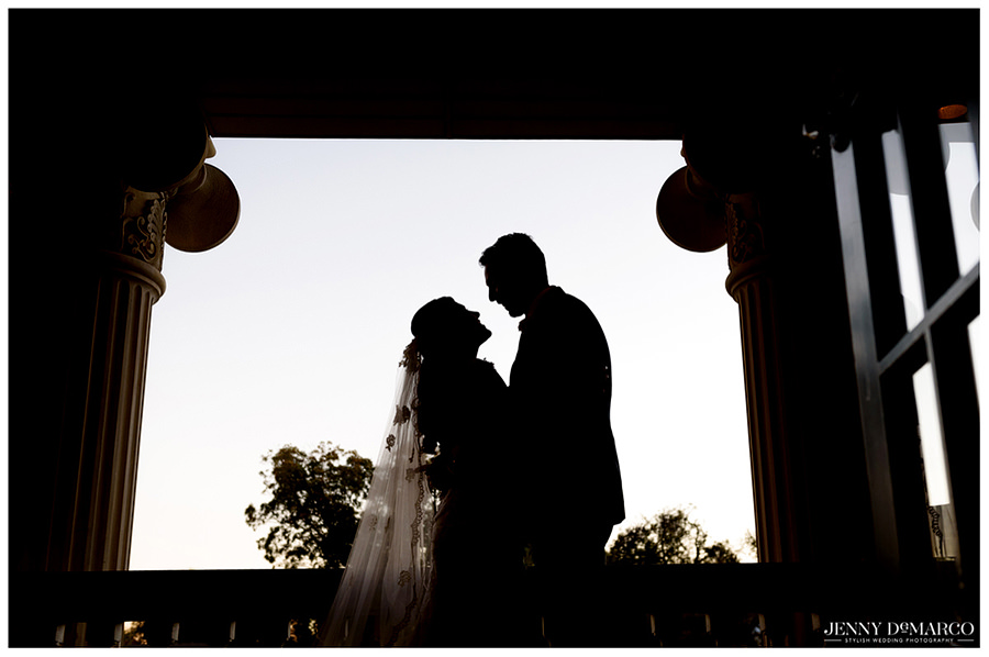 Bride and Groom silhouette on porch of Hotel Ella