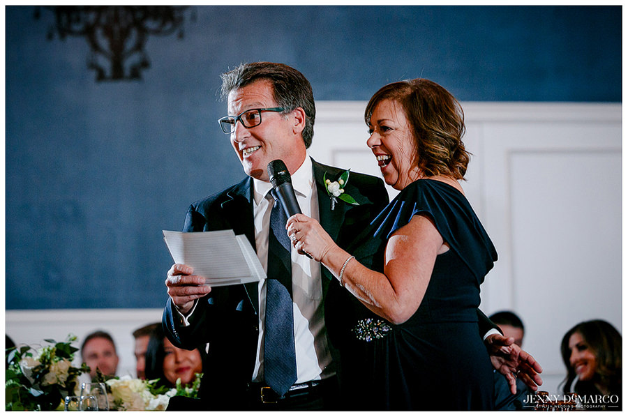 Parents of the bride giving a funny toast at the reception