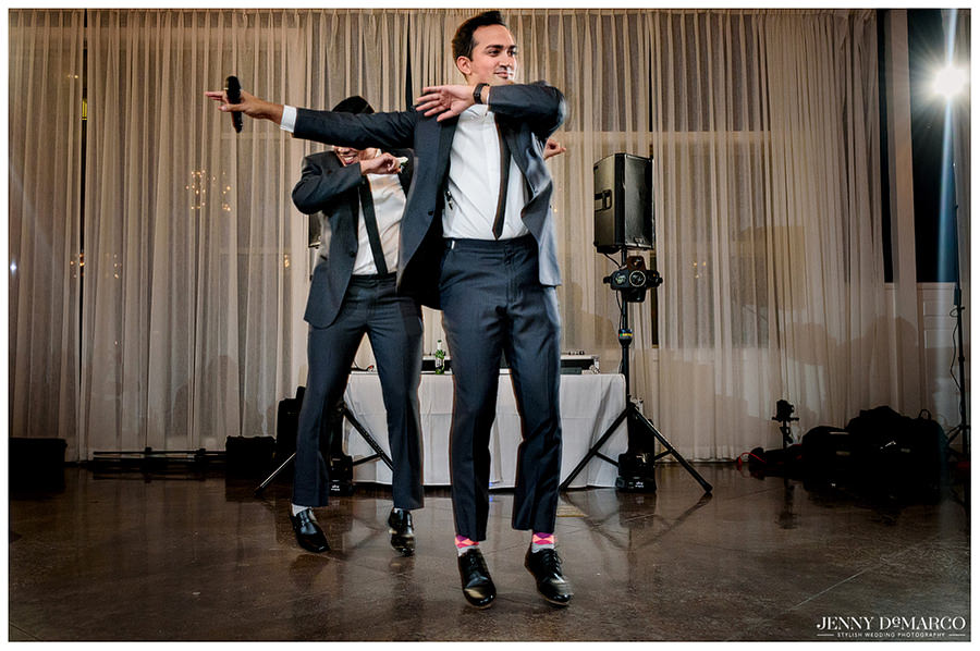 Groom delivering a toast while doing a silly dance