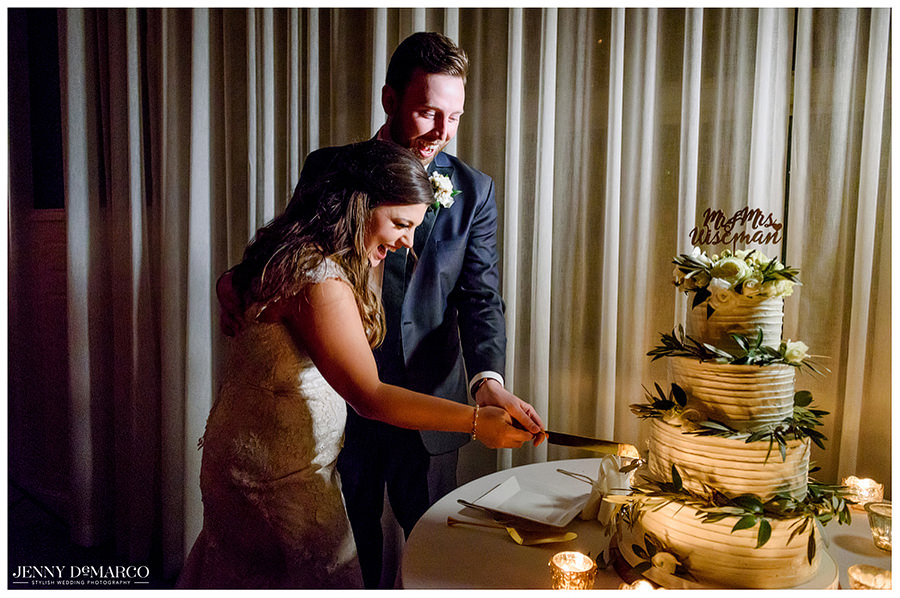 Bride and groom cutting the cake provided by Coco Paloma Desserts