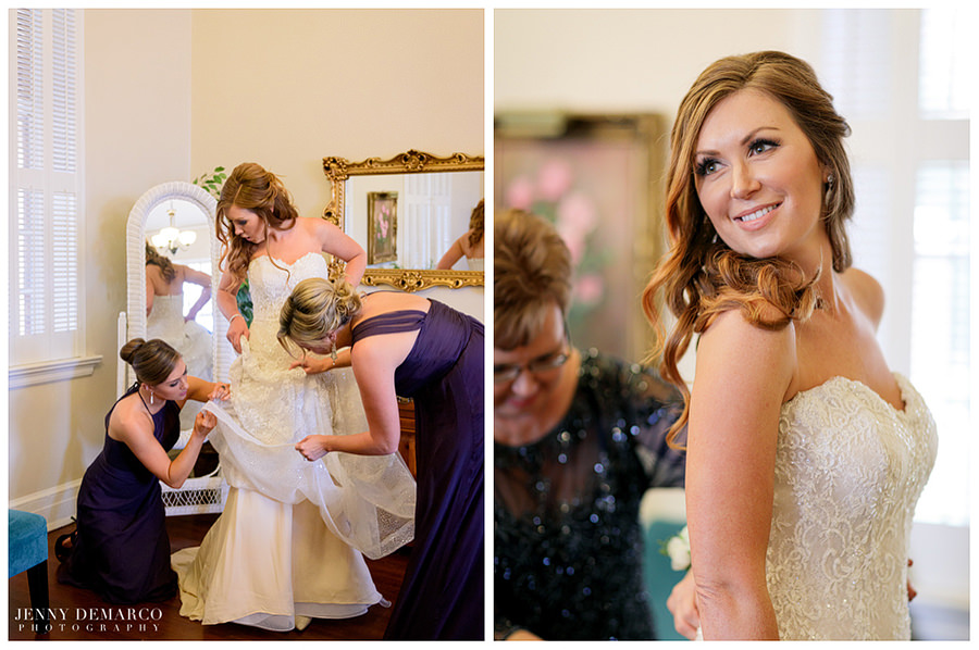 Mother of the bride helping her put her dress on