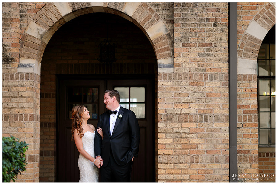 Bride and groom under beautiful arch at Central Christian church