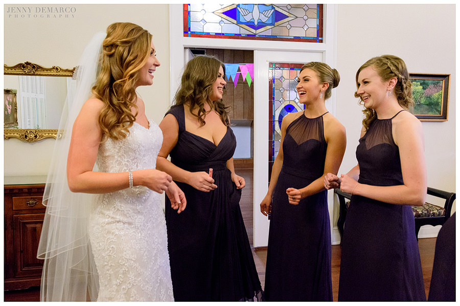 Bride and bridesmades sharing a laugh together after the wedding ceremony at Central Christian Church