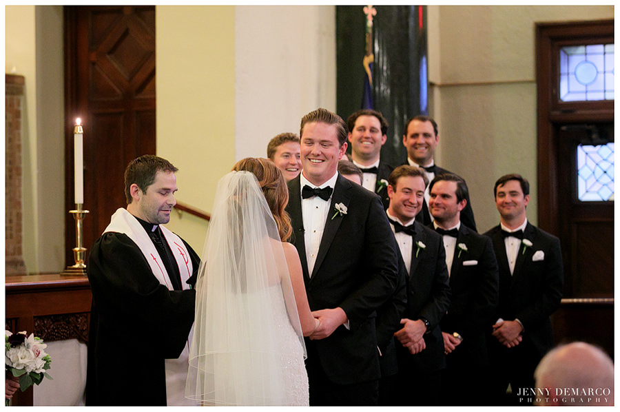 Groom smiling at bride at Central Christian Church during the ceremony