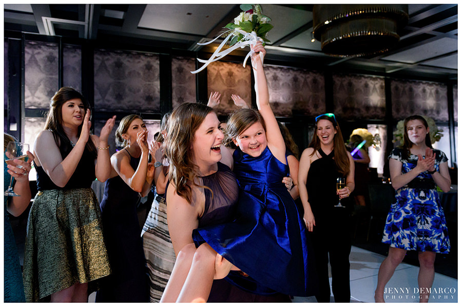 Tossing of the bouquet at wedding reception at hotel Van Zandt