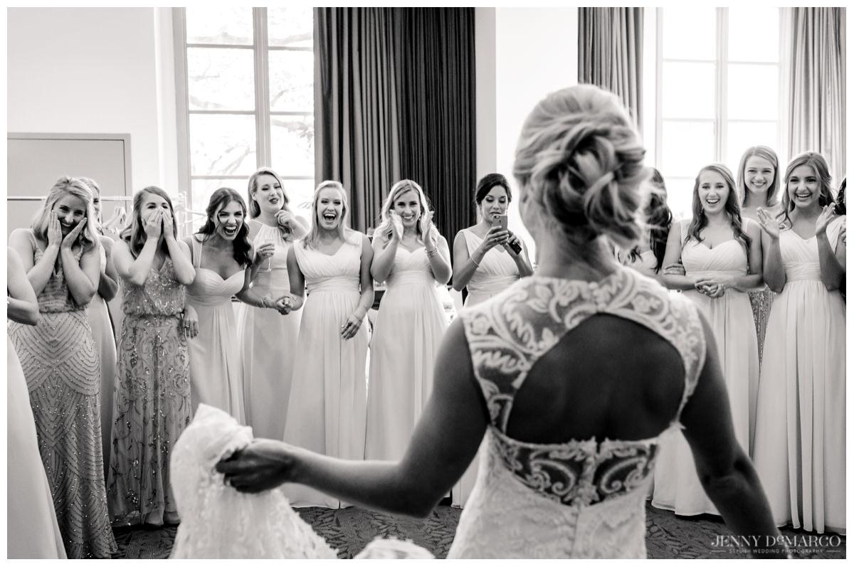 Bridesmaid first-look at beautiful bride's dress